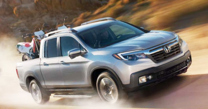 Ridgeline AWD RTL T Shown In Lunar Silver Metallic With Accessory Roof  Rails And Running